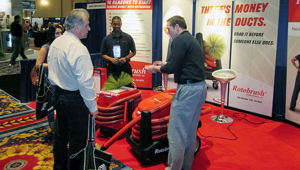 An ACCA contractor stops by the Rotobrush booth at the Indoor Air Expo.