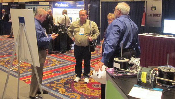 "Genteq had booth visitors ""rolling the dice."""