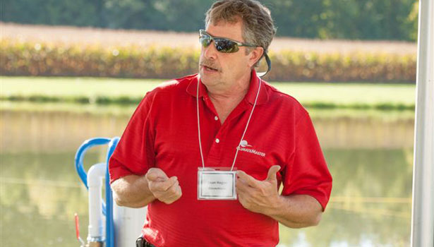 Sean Hogan, ClimateMaster trainer, demonstrates pond loop installations.
