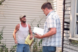 code enforcement official issues ticket to unlicensed contractor