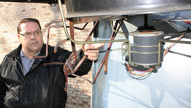 an a/c unit that has been stripped of its copper
