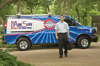 AireServ technician in front of van