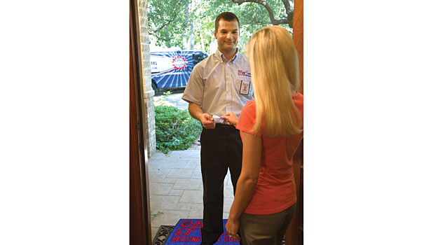 AireServ technician with customer at door