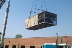 rooftop unit being lowered into place