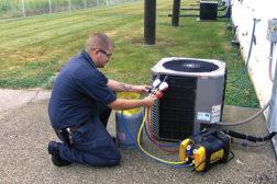 service technician recovering refrigerant