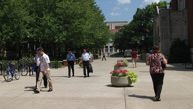 attendees stroll across the Purdue campus