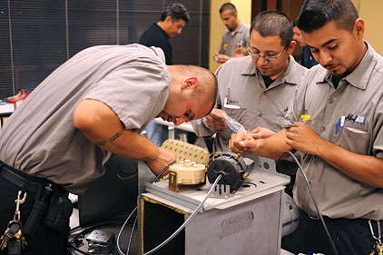 technicians perform a training exercise