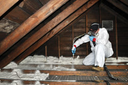 applying spray polyurethane foam on an attic floor
