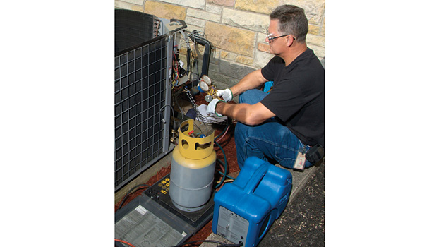 remove R-22 refrigerant from the system and collect it in a recovery cylinder