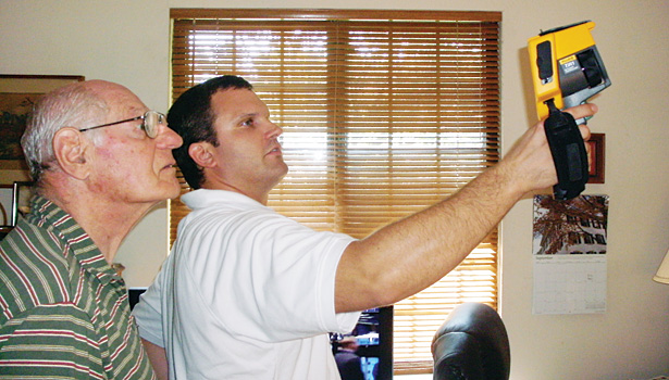 Tom Brown of Bright Home Energy Solutions, Elmsford, N.Y., does a home energy consultation with a customer.