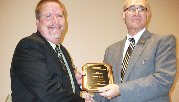 RSES International Speaker of the Year Rich Hoke, left, garners his award from Donaldson.
