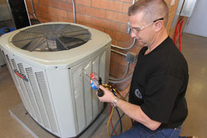 Journeyman Dan Tash from Sheet Metal Workers Local #359 in Phoenix checks on an air conditioning floor unit