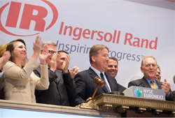 Ingersoll Rand chairman and CEO Michael W. Lamach (middle, with gavel) rang the closing bell of the New York Stock Exchange (NYSE) in celebration of two company milestones -- the 100th anniversary of Trane and 75th anniversary of Thermo King.