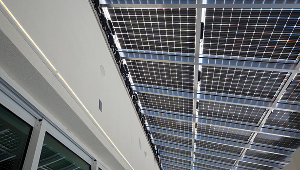 The 195-W solar panels are bifacial, meaning they can generate some electricity from reflected light that hits the bottom side of the panels.
