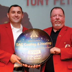 Tony Petrolle (left) and Randy Hamilton (right) of GAC Cooling & Heating accepted the Bryant Dealer of the Year award at the 2013 Bryant Dealer Rally.