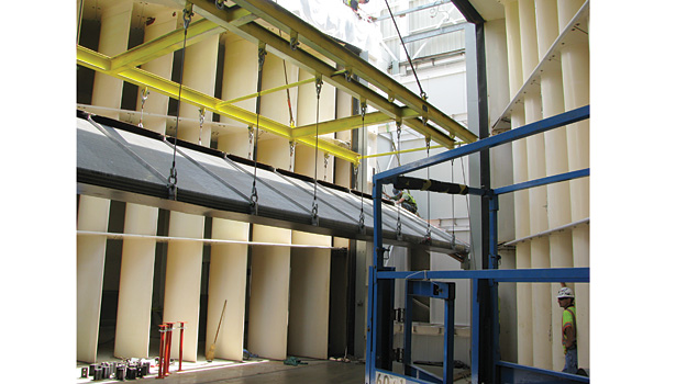 Each 50-foot-long coil was carefully lowered through the roof and placed on top of another coil. (Photo courtesy of Jacobs Technology.)