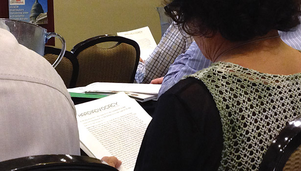 A HARDI member reads over a handout during a legislative update.