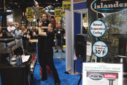 Juggling bar product, called flair bartending, was utilized to draw attendees at NRA to view the latest in spot cooling innovations from Port-A-Cool.