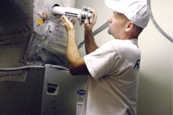 A service technician installs an RGF REME system. (Photo courtesy of RGF Environmental Group.)