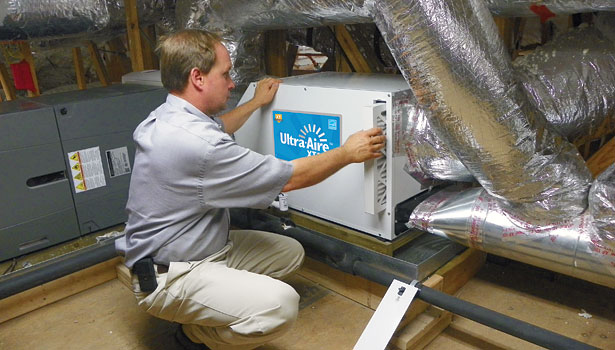Howard Stalls of Environmental Air Conditioning Services, Jacksonville, Fla., installs an Ultra-Aire unit in a home.