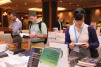 Customers thumb through the selection of offerings available at the ASHRAE Bookstore during ASHRAE's annual conference in Denver.