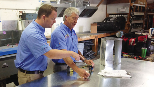 Father Bill Smith (right) and son Travis Smith work together at Sky Heating & AC in Oregon.
