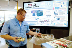 An employee from Terry's AC & Heating, Richmond, Texas, recycles a used mercury thermostat at one of Houston-based Johnson Supply's 24 thermostat collection points.