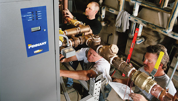 Technicians work on the installation of two Laars Pennant fan-assisted, sealed combustion boilers at Boise State University's student union building.