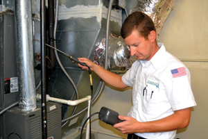 When replacing or servicing HVAC equipment, technicians have an opportunity to approach the customer about additional duct services, such as leakage testing. (Photo by Atchley Air, Fort Smith, Ark.)