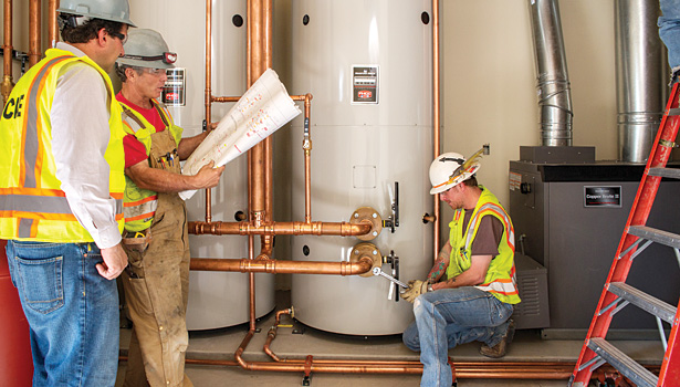 Technicians from mechanical contractor Commercial Design Engineering, Colorado Springs, Colo., install Bradford White eF water heaters and Copper Brute II boilers at a new facility in Fort Carson, Colo.