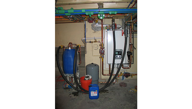 The new system was power flushed using a 1.5 hp centrifugal pump with 25-micron bag filters and 1¼-inch hose connections.