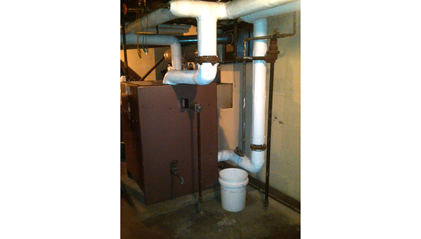 The old boiler with gravity distribution system was installed in the 1960s.