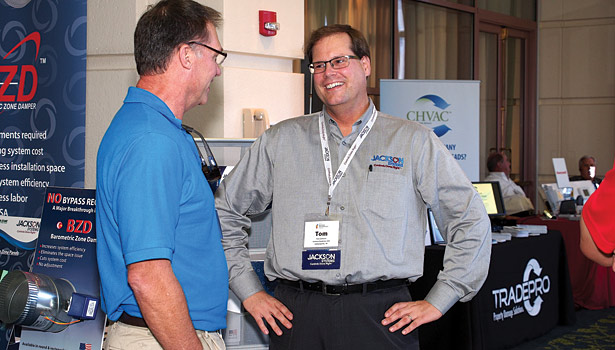 Tom Jackson of Jackson Systems has a laugh during the Building Performance trade show.