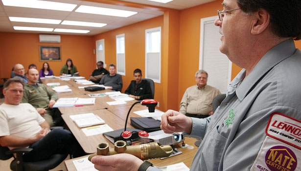 In the classroom, Baker shows his students how to use a Taco Wags Valve. (Photo by Nardella Photography Inc.)