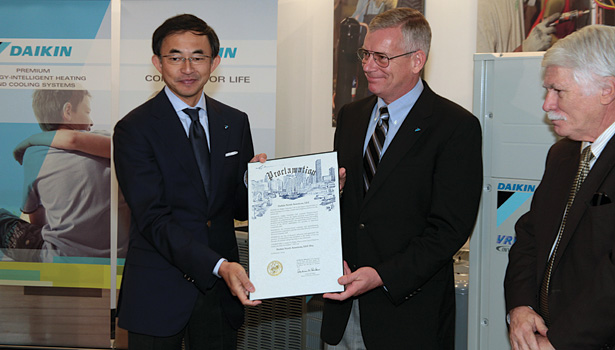 Takeshi Ebisu  and Dave Swift accept recognition that Nov. 7 was Daikin North America Day in Houston.