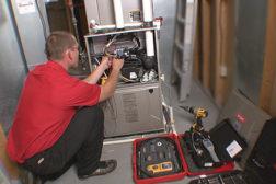 HVAC technician servicing a furnace