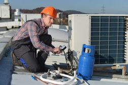 Technician servicing an HVAC unit