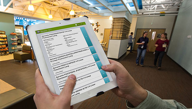 NREL Engineer Nicholas Long uses simuwatt Energy Auditor on his iPad to audit the lighting in a café on NREL's campus