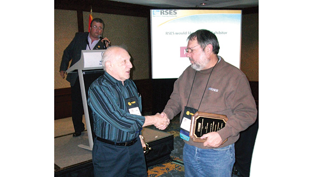 Stan Hollander, left, is congratulated on his Member of the Year honor by Jeff Lukanuski, who, earlier in the award ceremonies, accepted an award on behalf of the Southern Arizona Chapter for its educational programs.