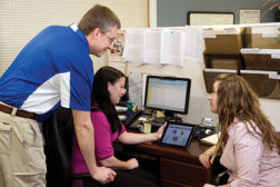 Dave Bloom, left, a PBCI-Allen comfort specialist, looks over a Wrightsoft load diagram with Allison Webster, assistant service manager, and Naomi Schwartz, accounting assistant.