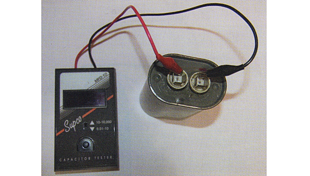 This capacitor checking instrument will read out in the capacitance of the particular capacitor. This reading should be compared to the rating printed on the capacitor.