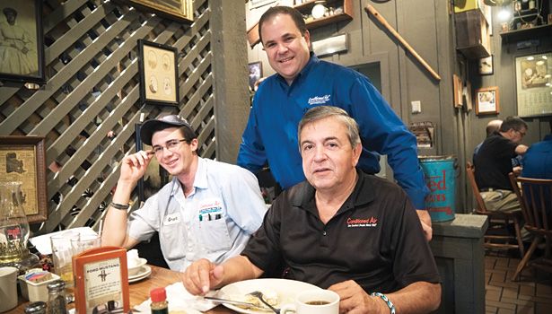 Coffee talk takes place among, from left, Grant Johnson, piper apprentice; Keith Walker, president and COO; and Ruben Velez, service department driver.