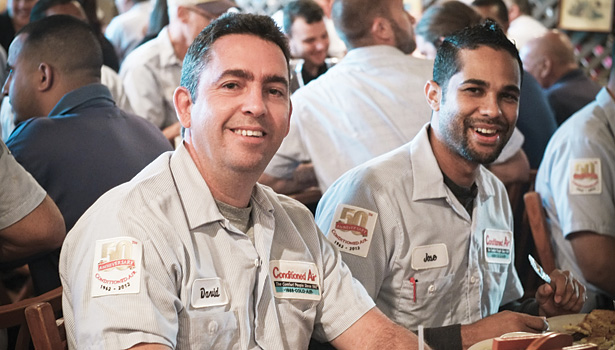 Part of the Conditioned Air team are Duct Mechanics David Molina, left, and Jose Ramos. Employees are eligible for numerous incentives recognizing exemplary achievement.