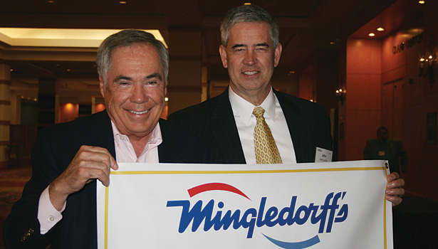 (Left) Bud Mingledorff, president of Mingledorffâ??s Inc., and John Lanier, COO of North American Technician Excellence (NATE), stand with the banner that Mingledorffâ??s Inc. received for certifying the most NATE technicians in 2013.