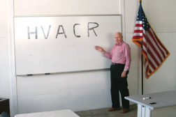 Aaron York Sr. stands at the white board of one of Yorkâ??s Quality Education & Training Center LLCâ??s new classrooms.