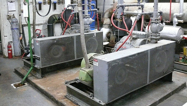 Shown is a compressor and chiller configuration at the ice arena, which was dealing with a leaking refrigerant system.
