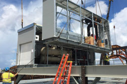 When an MCP is delivered to a site, a crane will lift the pieces into place, then the piping and electrical interconnections between modules will be reconnected. (Courtesy, Daikin Applied)