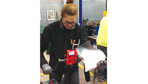 Heidi Brown uses a rotary hand flange forming machine to put a �¼-inch bend in the metal so it can be placed inside of a Pittsburgh lock to form the duct together.