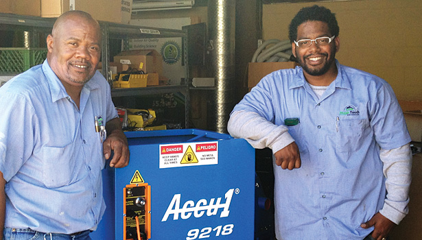 Magic Touch Mechanicalâ??s install technician Dajaunta Chatman (left) and install manager Rick Barrow (right) load the insulation blower back in the shop after a job.