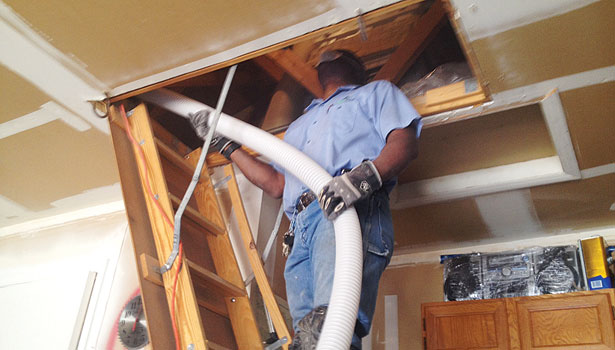 Magic Touch Mechanicalâ??s Rick Barrow, insulation department manager, checks in on this insulation job.